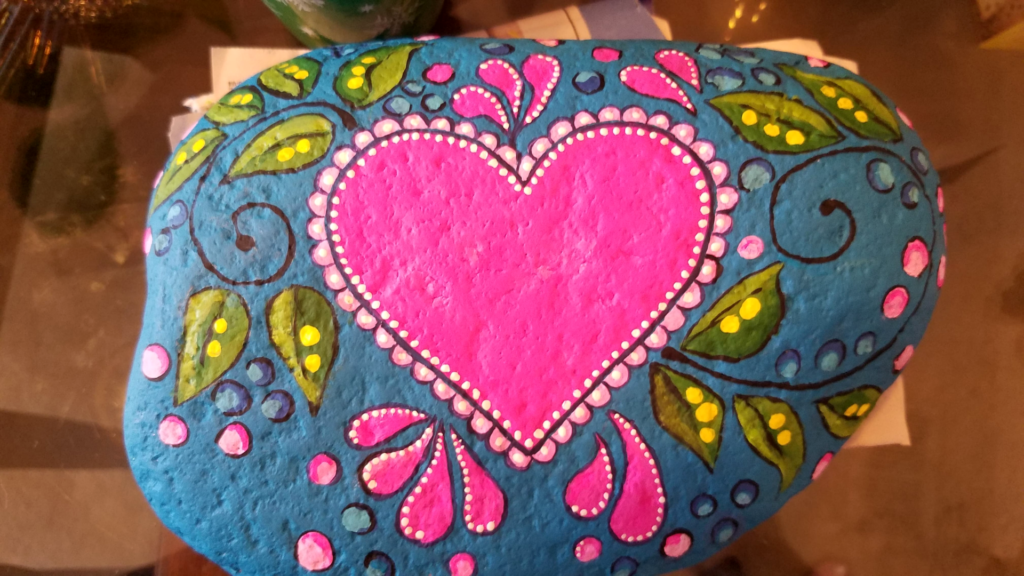 Heart and leaf painted rock