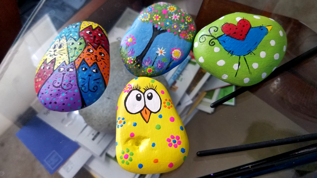 how to paint rocks. Bird, cat and tree.